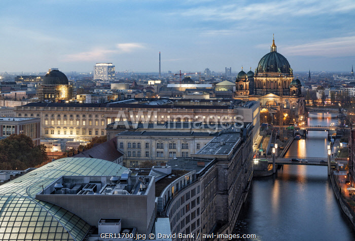 Berlin Cathedral and the new City Palace in the Mitte district at dusk.