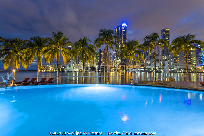 USA, Florida, Miami downtown business district with Mandarin Oriental Hotel's outdoor swimming pool.