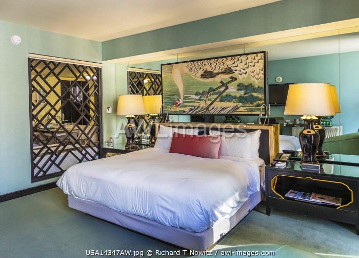 USA, Florida, Miami.  W-Hotel, bedroom with art on walls.