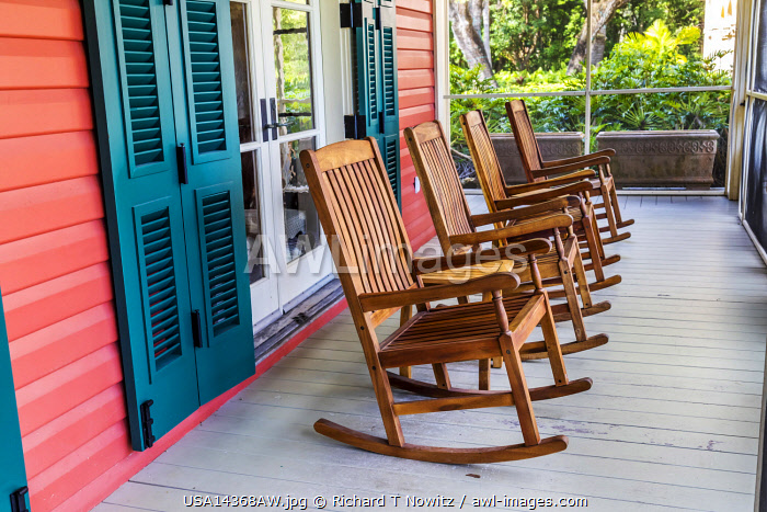 Miami, Florida, USA. The Charles Deering Estate, rocking chairs on the porch of  house museum on the National Register of Historic Places.