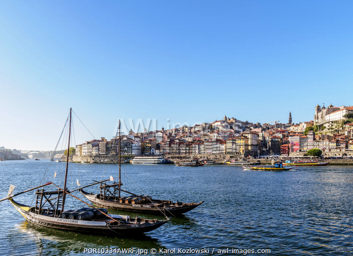 Traditional boats on Vila Nova de Gaia bank of Douro River, Porto Skyline in the background, Portugal
