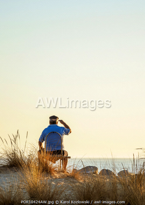 Man looking at the sea, Faro Beach, Ilha de Faro, Ria Formosa Natural Park, Faro, Algarve, Portugal