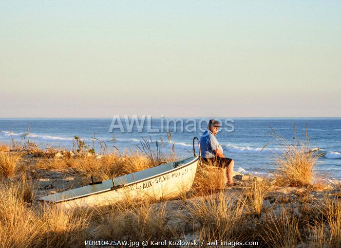 Man looking at the sea, Faro Beach, Ilha de Faro, Ria Formosa Natural Park, Faro, Algarve, Portugal