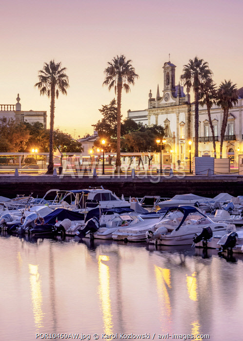 View over Marina towards Arco da Vila at dawn, Faro, Algarve, Portugal