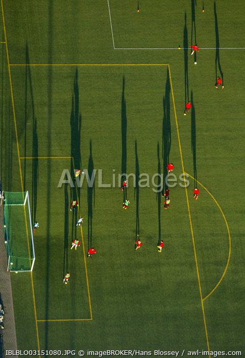 Aerial view, training on the football pitch of the Hammer Spielvereinigung SpVg sports association, players cast long shadows, Hamm, North Rhine-Westphalia, Germany, Europe