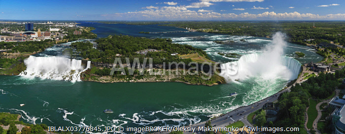 Panoramic aerial view on Niagara Falls from Canadian side with American Falls left and Canadian Falls or Horseshoe Falls on the right, USA and Canada