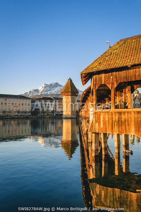 Lucerne, Switzerland. Kapellbrücke (Chapel Bridge) on Reuss river and mount Pilatus in the backdrop