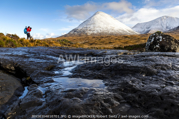 Photographer with snow-covered peaks of the Cullins Mountains, Sligachan, Portree, Isle of Skye, Scotland, United Kingdom, Europe