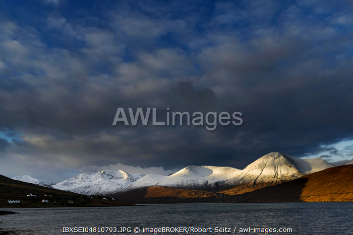 Snow-covered Cullins mountain range with Loch Ainort in dramatic light, Portree, Isle of Skye, Scotland, United Kingdom, Europe