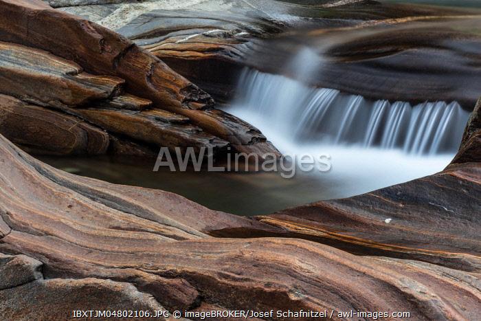Mountain stream, water flowing over granite rocks, Verzasca river, Verzasca valley, Locarno district, Canton Ticino, Switzerland, Europe