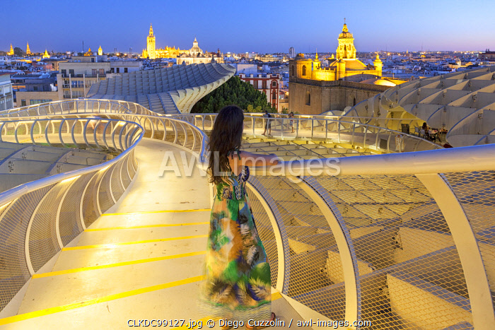 A tourist on the upper level of Metropol Parasol at dusk, Seville, province of Seville, Andalusia, Spain (MR)