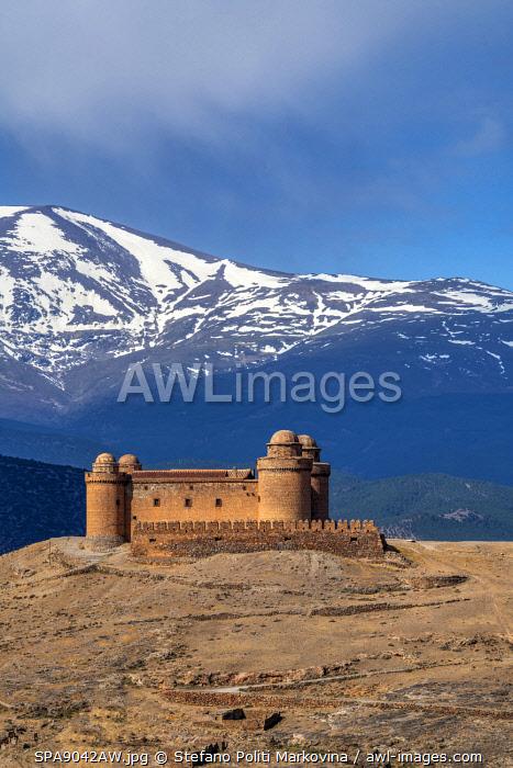 Castillo de la Calahorra castle with the Sierra Nevada mountain range in the background, La Calahorra, Andalusia, Spain