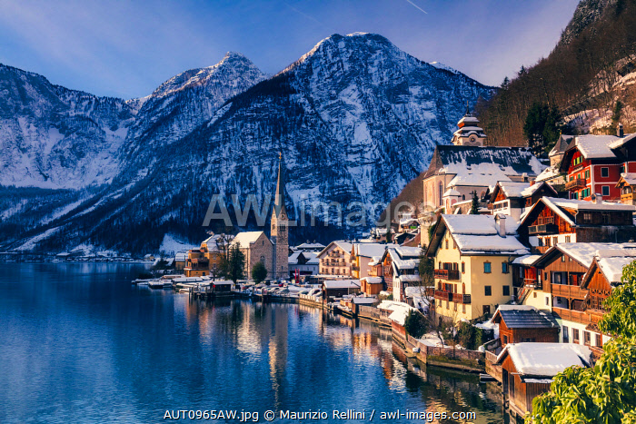 awl-images.com - Austria / Typical village called Hallstatt con the Hallstatter see at sunrise with the houses reflecting in the lake