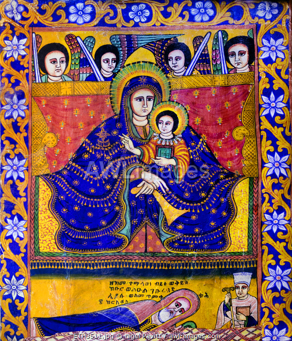 Ethiopia, Aksum, Tigray Region.  A painting of Mary and Jesus in the church of St. Mary of Tsion. Their exceptionally long fingers signify the painting is in the Gondarine style. Jesus is holding the gospel.