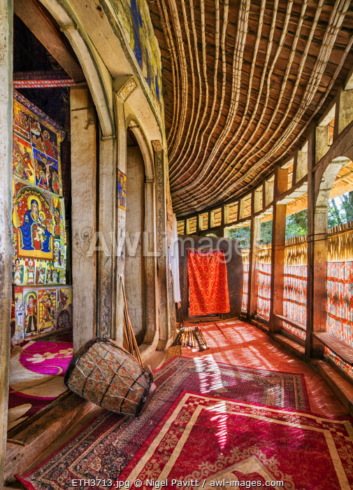 Ethiopia, Lake Tana, Amhara Region. The covered ambulatory of the church at Azwa Maryam Monastery. The decorated walls of the sanctuary are visible through the massive doorways on the left.