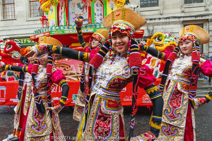 awl-images.com - England / England, London, Chinatown, Chinese New Year Parade, Female Parade Participants in Colourful Chinese Costume
