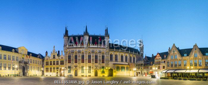 Belgium, West Flanders (Vlaanderen), Bruges (Brugge). Stadhuis van Brugge city hall and Brugse Vrije on Burg Square at dusk.