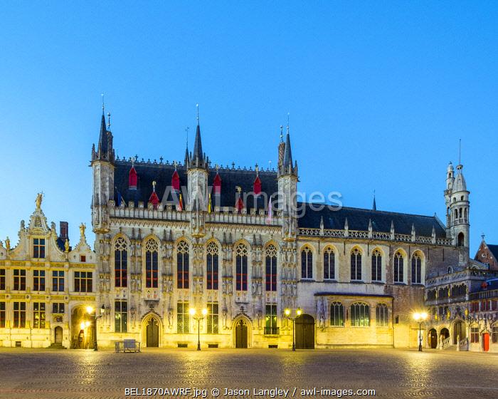 Belgium, West Flanders (Vlaanderen), Bruges (Brugge). Stadhuis van Brugge city hall and Brugse Vrije on Burg Square, at dusk.