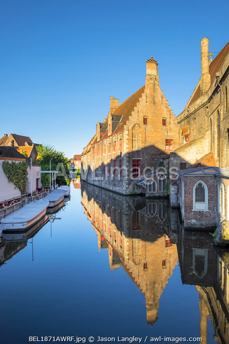 Belgium, West Flanders (Vlaanderen), Bruges (Brugge). Historic Sint-Janshospitaal (St. John's Hospital) on the Bakkersrei canal.
