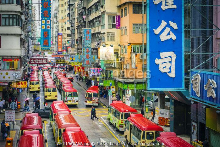 Busses lined on Tung Choi Street in Mong Kok at rush hour, Kowloon, Hong Kong, China