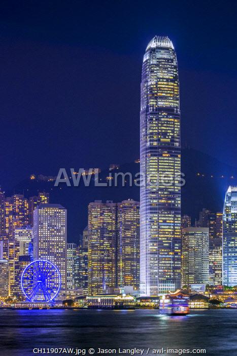 Hong Kong skyline, IFC Tower and skyscrapers on Hong Kong Island at night seen from Tsim Sha Tsui, Hong Kong Island, Hong Kong, China