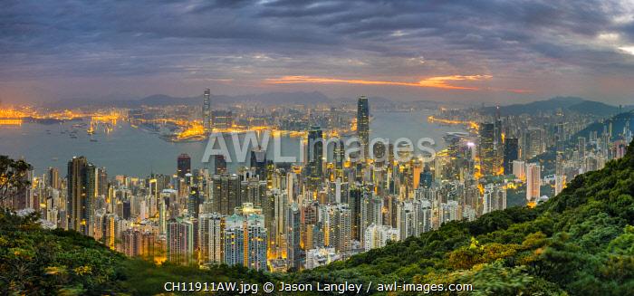 Panoramic view of Hong Kong skyline at dawn from Lugard Road on Victoria Peak, Hong Kong Island, Hong Kong, China
