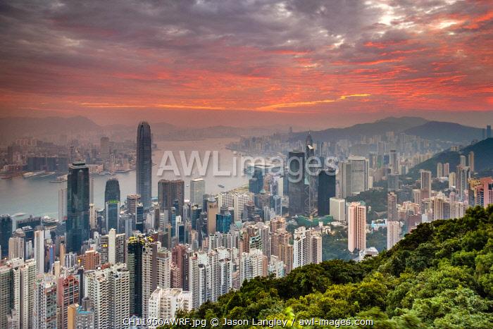 Hong Kong skyline at sunrise from Lugard Road on Victoria Peak, Hong Kong Island, Hong Kong, China