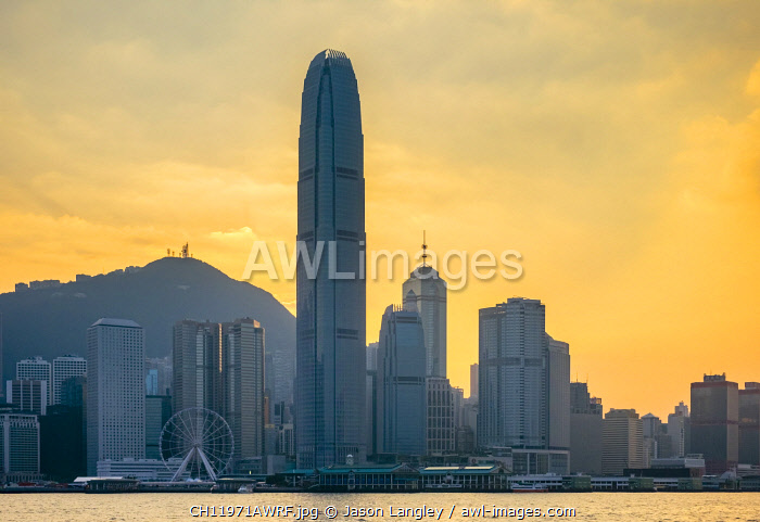 Hong Kong skyline, skyscrapers on Hong Kong Island seen from Tsim Sha Tsui at sunset, Hong Kong, China