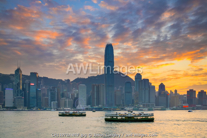 Hong Kong skyline, skyscrapers on Hong Kong Island skyline at sunset seen from Tsim Sha Tsui, Kowloon, Hong Kong, China