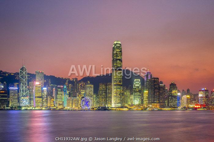 Hong Kong skyline, skyscrapers on Hong Kong Island seen from Tsim Sha Tsui at sunset, Hong Kong, China