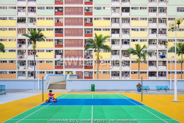 Child playing in front of Choi Hung Estate, one of the oldest public housing estates in Hong Kong, Wong Tai Sin District, Kowloon, Hong Kong, China