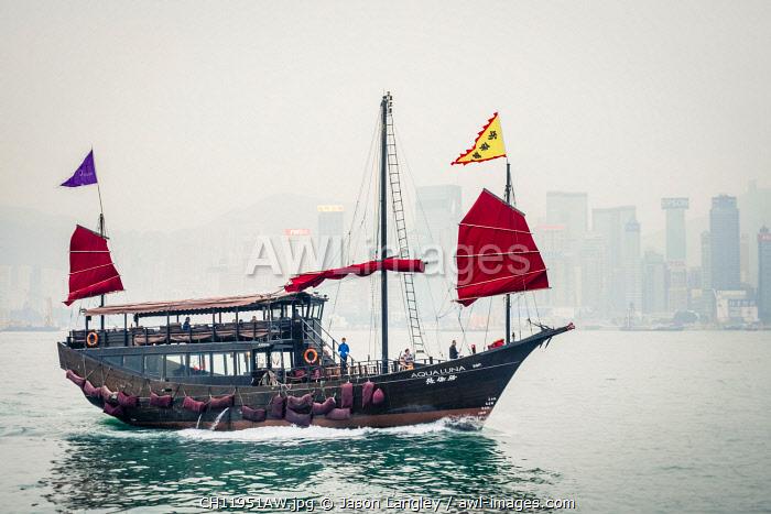Aqua Luna traditional Junk ship sailing in Victoria Harbor, Tsim Sha Tsui, Kowloon, Hong Kong, China