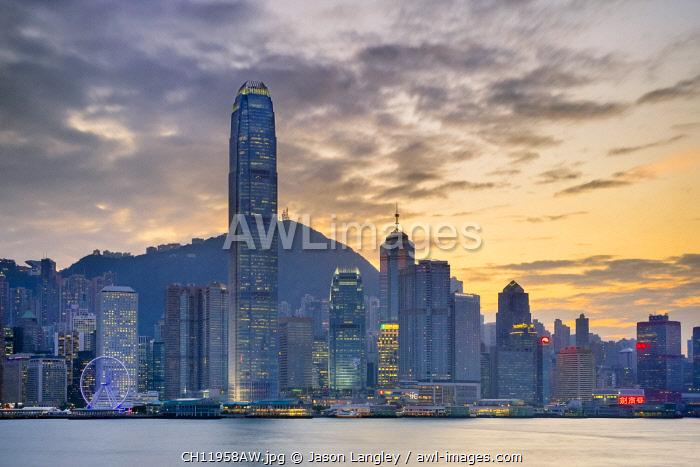 Hong Kong skyline, skyscrapers on Hong Kong Island skyline at sunset seen from Tsim Sha Tsui, Kowloon, Hong Kong, China
