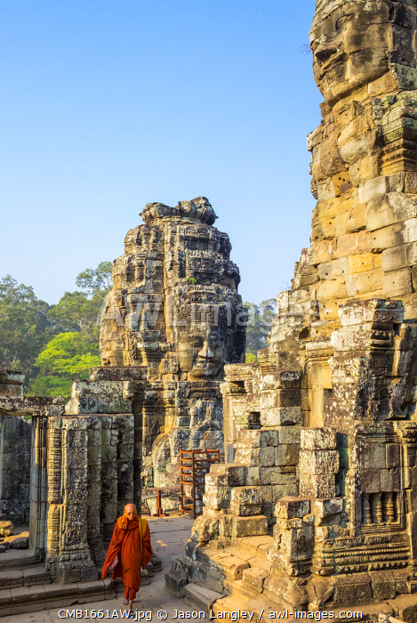A monk walk through Prasat Bayon temple ruins, Angkor Thom, UNESCO World Heritage Site, Siem Reap Province, Cambodia