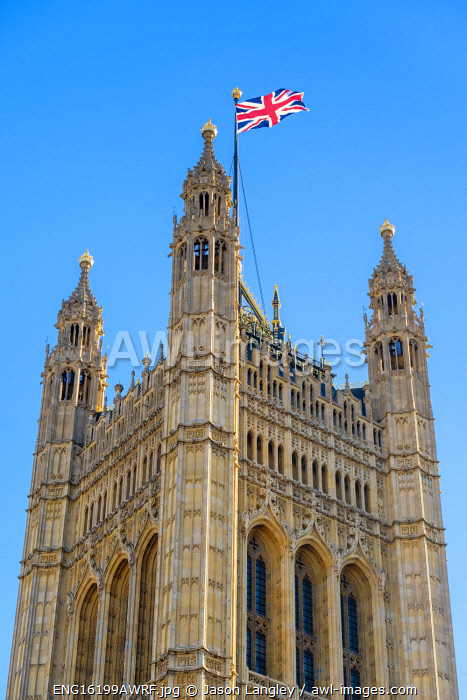 United Kingdom, England, London. Union Jack flag flown above Victoria Tower, Palace of Westminster, the houses of Parliament of the United Kingdom.