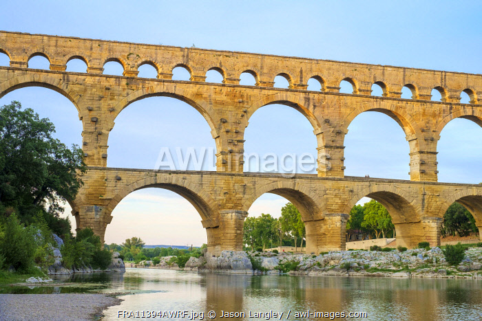 Pont du Gard Roman aqueduct over Gard River at sunset, Gard Department, Languedoc-Roussillon, France