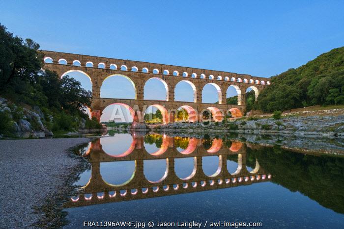 Pont du Gard Roman aqueduct over Gard River at dusk, Gard Department, Languedoc-Roussillon, France