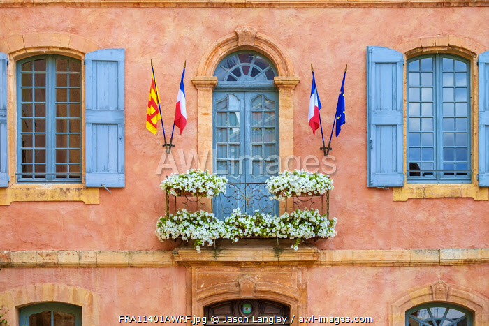 Colorful ochre colored façade of Mairie (mayor's office) in Roussillon, Vaucluse, Provence-Alpes-Côte d'Azur, France