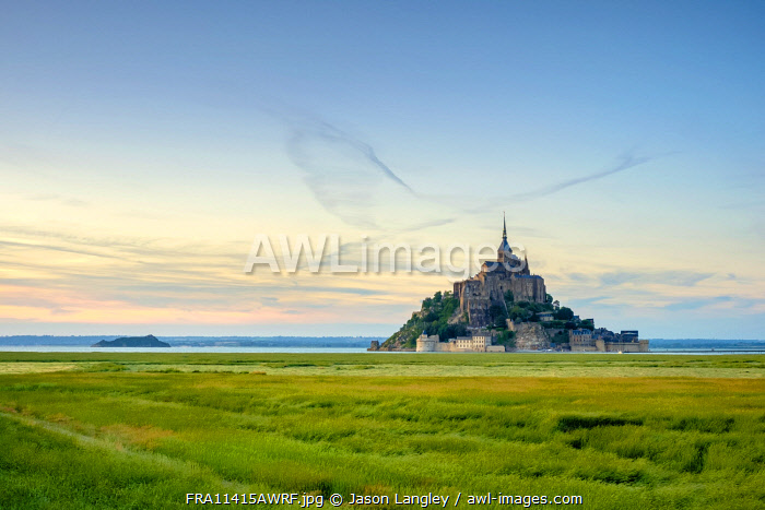 France, Normandy (Normandie), Manche department, Le Mont-Saint-Michel. Abbaye du Mont-Saint-Michel at sunset, UNESCO World Heritage Site.