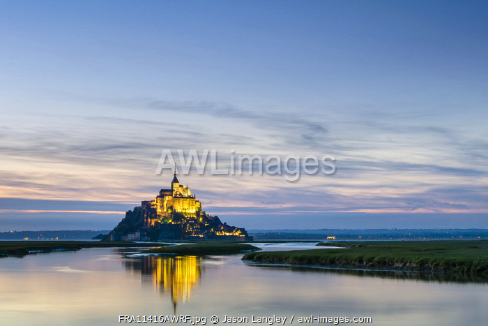 France, Normandy (Normandie), Manche department, Le Mont-Saint-Michel. Abbaye du Mont-Saint-Michel at sunset, UNESCO World Heritage Site.