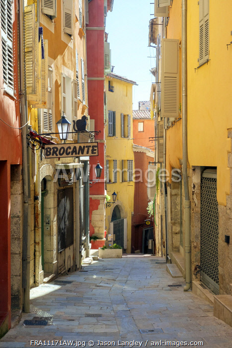 Colorful buildings and Brocante antique dealer's sign on sunny afternoon in Grasse, Alpes-Maritimes, Provence-Alpes-Côte d'Azur, France.
