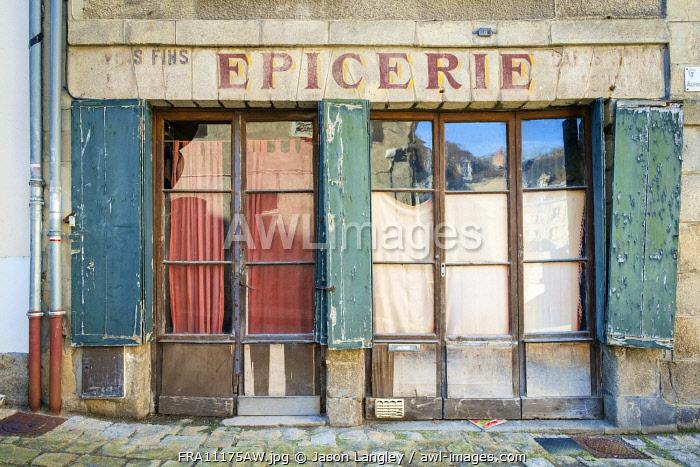 Abandoned storefront vintage painted sign of old Epicerie market store, Aubusson, La Creuse Department, Limousin, France.
