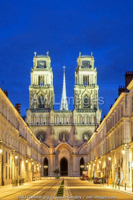 Façade of Orléans Cathedral (Basilique Cathédrale Sainte-Croix) seen down Rue Jeanne d'Arc at dusk. Orléans, Loiret Department, Centre, France.