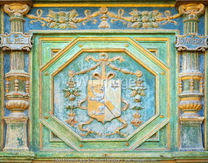 Carved painted coat of arms of Katherine Briçonnet on wooden front door of Château de Chenonceau castle, Chenonceaux, Indre-et-Loire, Centre, France.
