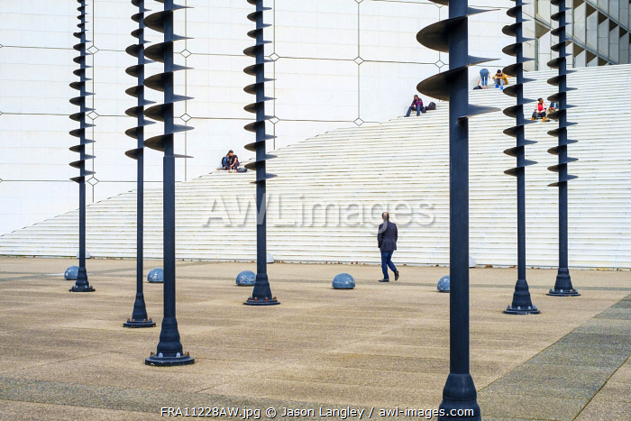 "Man walking in front of Light Signals sculpture by Greek artist Panagiotis ""Takis"" Vassilakis, La Défense, Paris, Île-de-France, France."