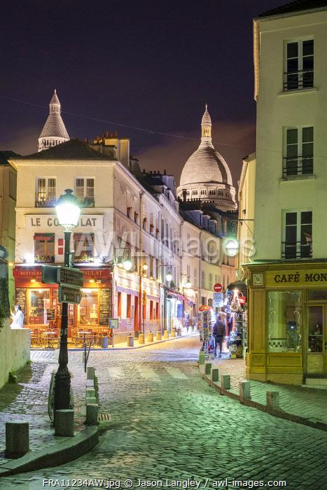 Dome of Sacré-Coeur Basilica over buildings in Montmartre at night, Paris, Île-de-France, France