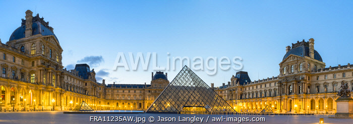Courtyard and glass pyramid of the Louvre Museum at sunrise, Paris, Île-de-France, France