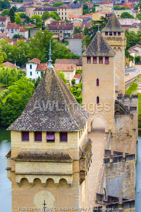 High angle view of medieval Pont Valentré bridge over the Lot River and town of Cahors, Lot Department, Midi-Pyrénées, France