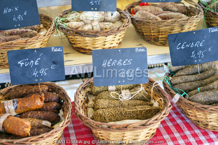 Saucission sec, dry cured sausage for sale at weekly farmer's market in bastide town of Monpazier, Dordogne Department, Aquitaine, France