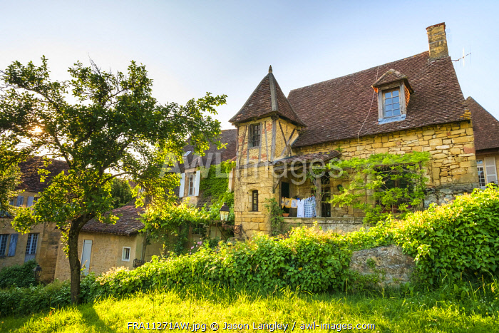 Beautiful old stone house on Rue Montaigne in late afternoon sun, Sarlat-la-Canéda, Dordogne Department, Aquitaine, France